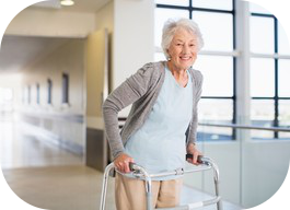 Older woman walking with a walker